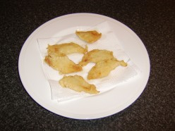 The whiting goujons are drained on kitchen paper before being served