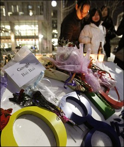 Sympathetic people leave flowers and candles at the Google's Chinese headquarters after hacked.
