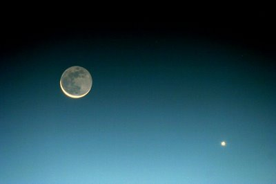 Venus, the Morning Star, next to the Moon. Venus is very bright just before sunrise.