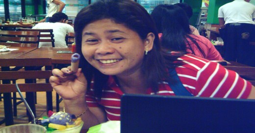 My cousin who's fond of eating in a fast food outlet (Photo by Travel Man Sept. 14, 2011)