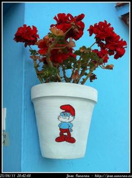 smurf logo on flowerpot