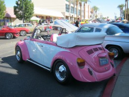 "Aww, a little pink VW ""bug""."