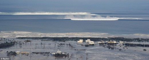 The tsunami races through the ocean as it reaches land on the north east coast of Japan in March 2011
