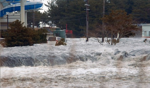 The raging waters rush through the streets of the Fukushima district in Japan. The city's nuclear plant was damaged by the tsunami