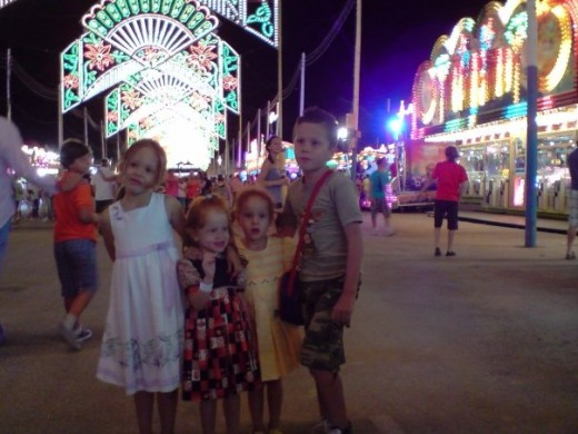 My kids at la Cala`s fairground, Mijas Costa