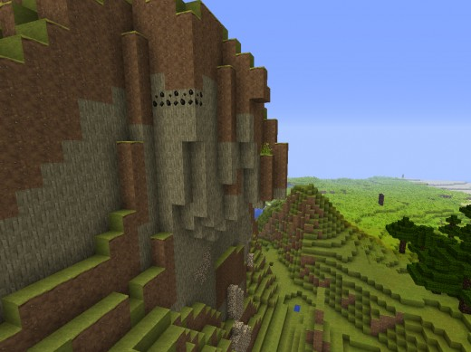 A tall Minecraft cliff, complete with high visibility coal ore.