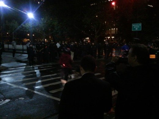 TWITPIC  | The cop:protestor ratio @ the [closed] Brooklyn Bridge entrance is easily 2:1 right now. #OccupyWallStreet
