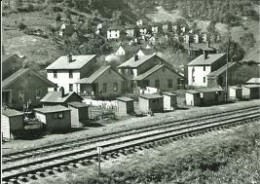 All these houses are now gone and the houses on the hill in the background are now filled with overgrowth and trees.