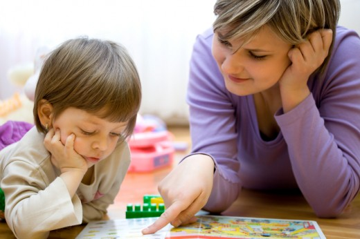 Speech Language Pathologist and Young Child During Speech Disorder Assessment