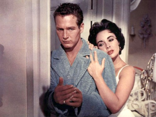 "LIZ TAYLOR, THE QUEEN OF HOLLYWOOD, IN A SCENE FROM ""CAT ON A HOT TIN ROOF,"" WITH HANDSOME CO-STAR, PAUL NEWMAN."