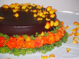 Cake from our local bakery with wholesale flowers arranged by a friend of the family.
