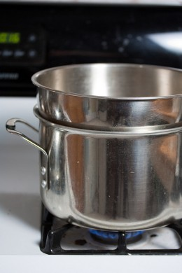If you don't have a double boiler - no problem. You can use a broad based bowl over a deep sauce pan as pictured here.