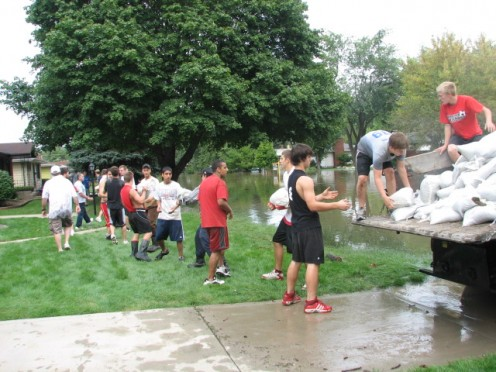 The effort to sandbag streets were not initiated until after the river had crested the night before.