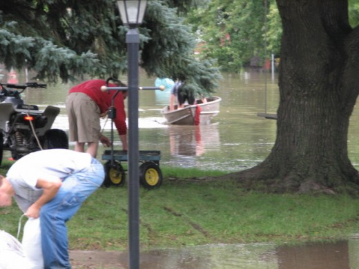 My ugly little boat was enlisted to carry sandbags when the Town Trucks could not get in where they were needed most.