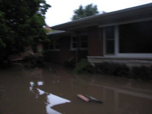 The water continued to rise through the day. We were praying it would not reach the upper level of our house.