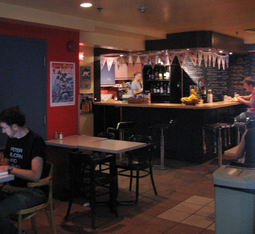 The communal kitchen area is adjacent to the cafe.
