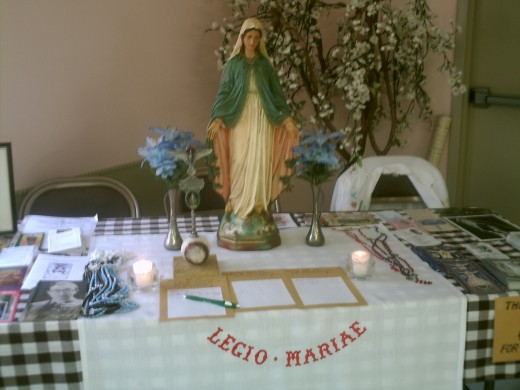 The Legion of Mary set up their information and devotional booth blessing with its beauty the families and meals displayed before it.