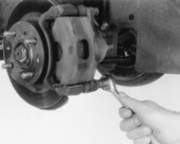 Removing and Replacing old worn front brake pads is actually much easier than it looks. All you need is a few basic tools, which include a hydraulic floor jack, socket wrench, pair of pliers and a C-Clamp and your ready to get started.