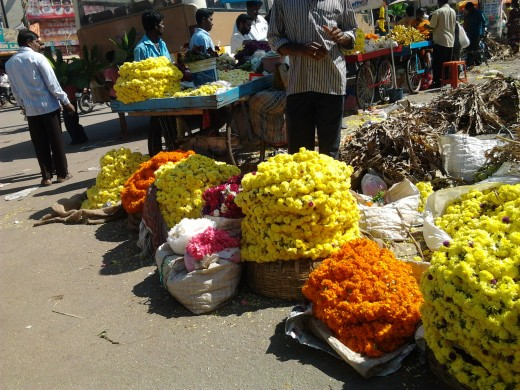 Streets are lined with hawkers selling flowers on the eve of the festival.