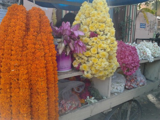 This flower seller has garlands of marigold, chrysanthemums and lotus flowers, jasmines,and ghanagale.