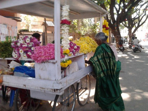 A flower seller outside the local temple.