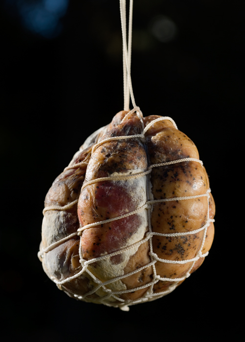 culatello hanging.