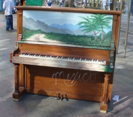 A painted piano on Denver's 16th Street Mall for public use.