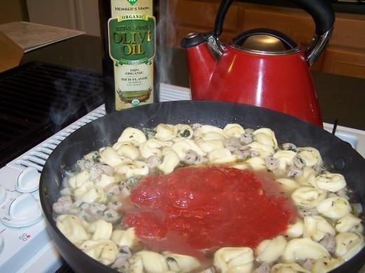 Add crushed tomatoes.