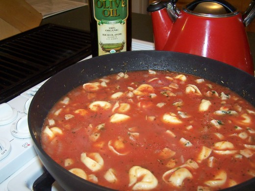 Stir in the crushed tomatoes and let simmer on a lower temperature for about 15 minutes.