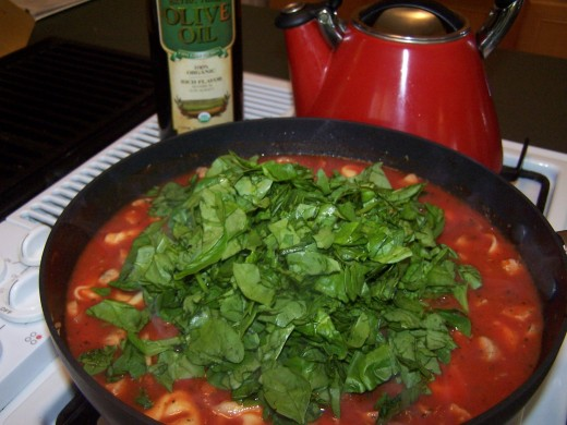 Add chopped spinach to the tortellini soup.