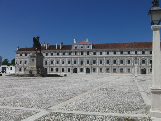 The Palace where the future king of Portugal lived as Noble. The Statue in the middle of the square is the king  D. João IV, in his horse.
