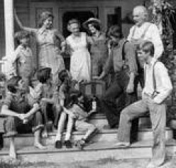 THE WALTONS ENJOYING A GAB SESSION ON THE FRONT PORCH.