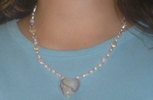 This is what a handmade necklace with a heart pendant looks like when completed.