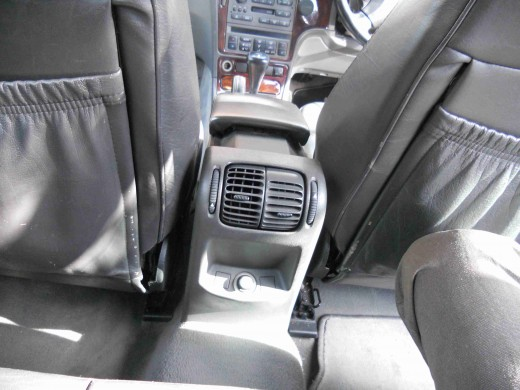 Saab 9-5 back seat showing heater, all leather seats.