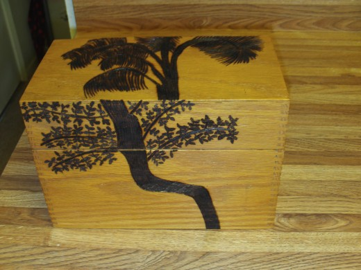 Here is a picture of the box after I finished wood burning on the trees.