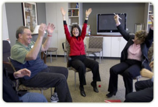 Dr. Katherine Puckett, National Director of Mind-Body Medicine at CTCA, holds a group session in laughter therapy for patients at Midwestern Regional Medical Center.