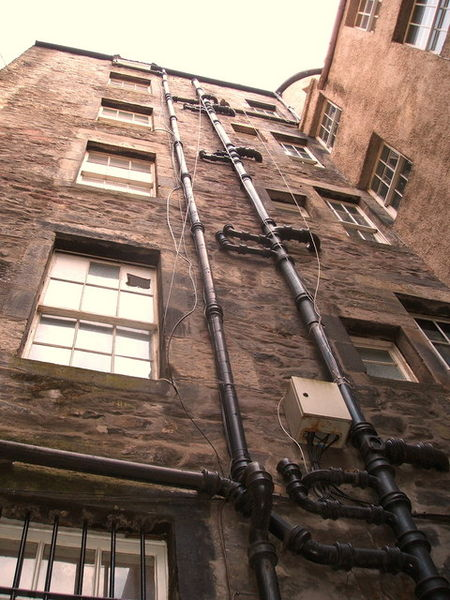 Tenement Buildings Looking up at tenement buildings outside the Jolly Judge pub, just off Lawnmarket.
