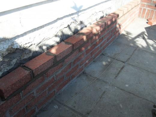 Laying the new bricks.