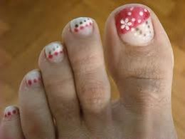 White flower and black red dots nail art design