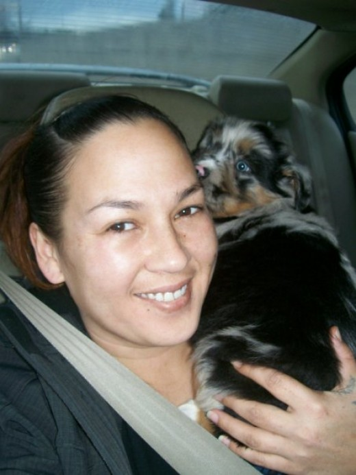 December 2009- On the way home and on my shoulder. See my grin, I said I was super happy!