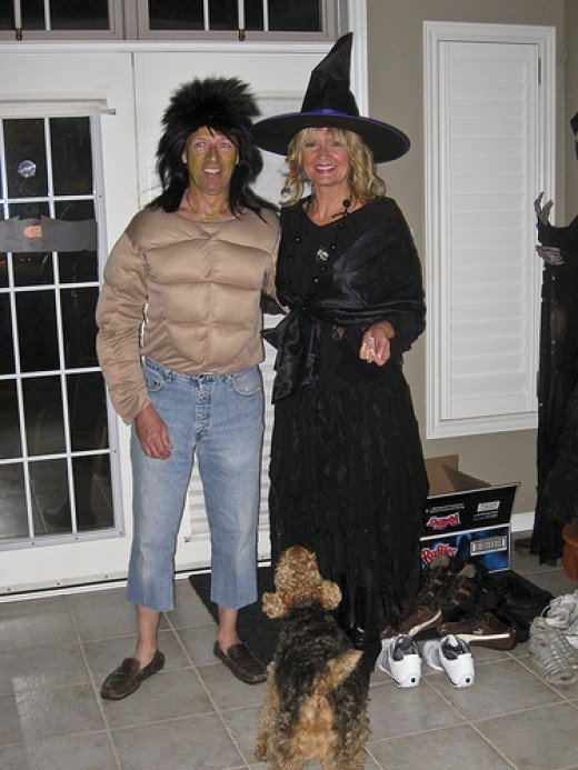 A WITCH ON THE RIGHT AND A BILLY RAY CYRUS WANNABE, ON THE LEFT, A SURE-FIRE HIT AT ANY HALLOWEEN BALL.