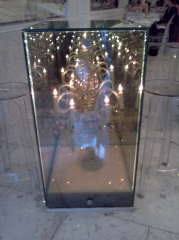 Chandeliers in glass boxes are the decor at Qi