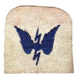 On a sailors best going ashore uniform this badge would be made of gold wire sewn again the navy blue.