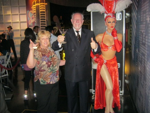 Hanging with the Mayor of Las Vegas and a showgirl.