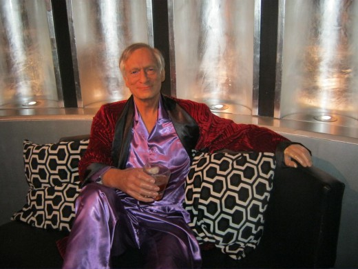 "Hugh Hefner ""chillin"" on a couch."