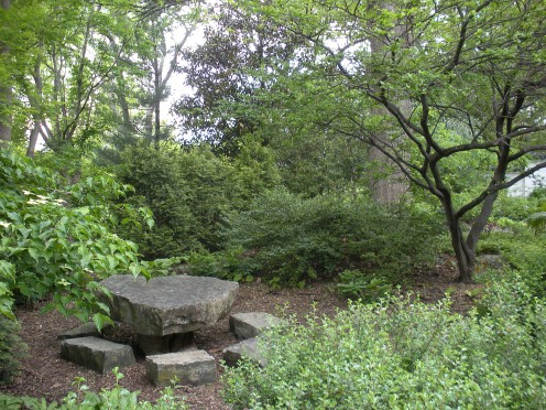 "Photo 3 - I love how they used big rocks in this garden, to create a table with ""seats.""  Granted, they are cut some, but the idea is there to use rocks to make a picnic area."