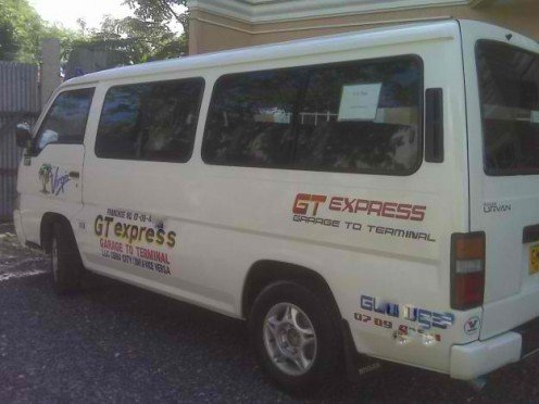 A closed-van used for public transport (V-Hire) with air condition.