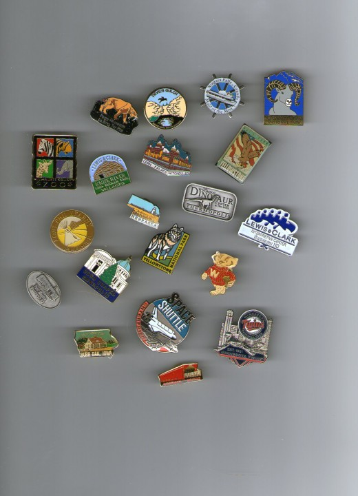 Pins from Rocky Mountain National Park, Niagara Fall's Maid of the Mist, Lewis & Clark Center in Washburn, ND, Laura Ingalls Wilder's home in Burr Oak, Iowa, the La Brea Tar Pits in Los Angeles, & Milwaukee Zoo.