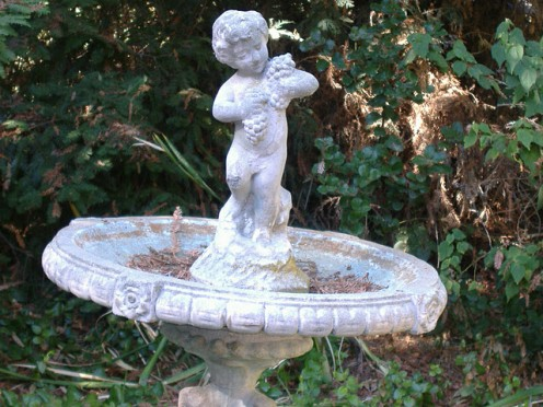This is a close-up of the angel on the top of the bird bath. This is beautiful with it's bleached out colors and wonderful scroll-work