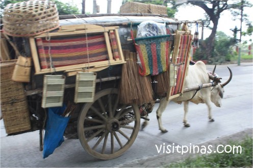 Cow-pulled cart loaded with goods for sale
